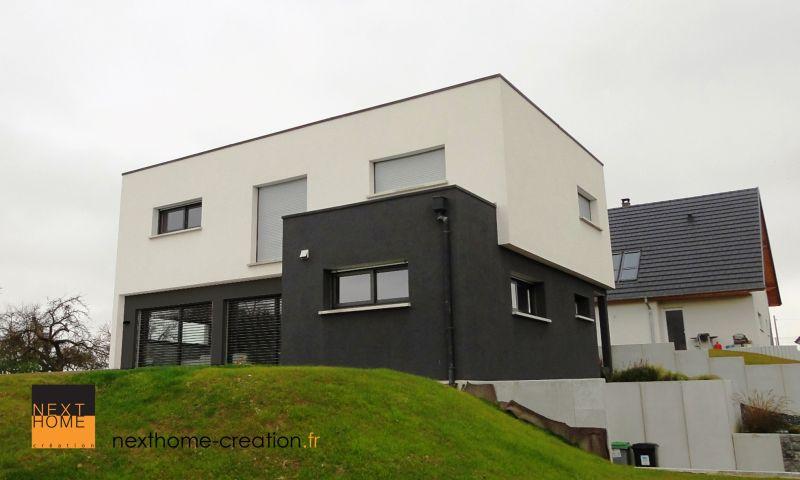 maison contemporaine toit plat et garage sous sol nexthome cr ation. Black Bedroom Furniture Sets. Home Design Ideas