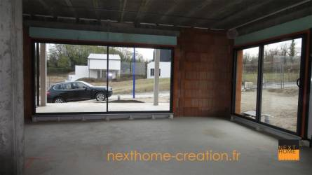 Maison moderne toit plat garage sous sol nexthome cr ation for Garage volkswagen haut rhin